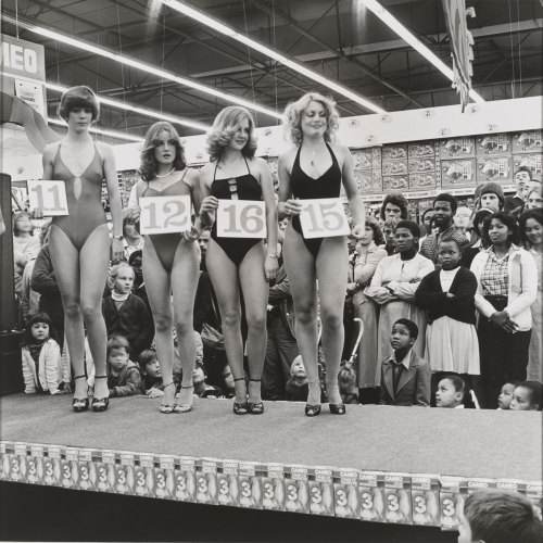 'Saturday morning at the Pick 'n Pay Hypermarket: Miss Lovely Legs Competition' Boksburg, 1980 - Photograph by David Goldblatt