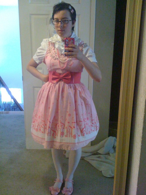 I settled on this coord for the 27 July meetup.  Pardon that I am not wearing make up in the photo, on the actual day I will have eyeshadow, foundation, eyeliner, lip gloss, and face stickers.  (I chose this JSK over my other one only cos the other one has a spot on it that I need to figure out how to get out.) Blouse - Fan+FriendJSK - BodylineShoes - BodylineGlasses - Betsey Johnson  (Not really part of the coord as they're my normal glasses but I get so many compliments on them because they have pink hearts on the sides and they totes work with lolita)EVERYTHING ELSE - offbrand, found at vintage/thrift stores or Claires  My new petticoat is going to be ordered next week with my next paycheck, so I will have a more bell-shaped one instead of just my A-Line one to wear. Thoughts?  Advice?