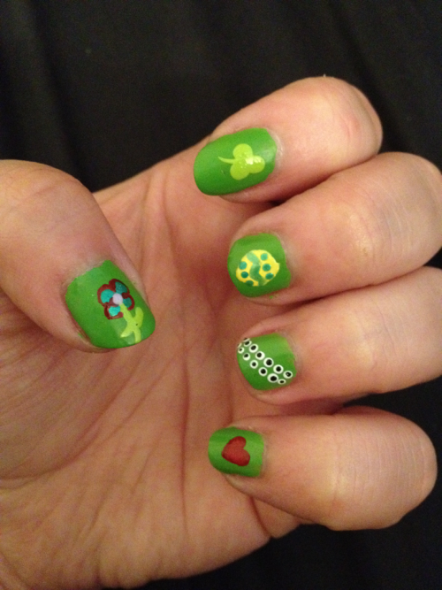 Working on my holiday nail designs… Thumb: Flower (Was going to be a Christmas tree, but I messed up. LOL) Index: Three leaf clover for St. Patrick's Day Middle: Easter Egg Ring: Eyeballs for Halloween Pinky: Heart for Valentine's Day