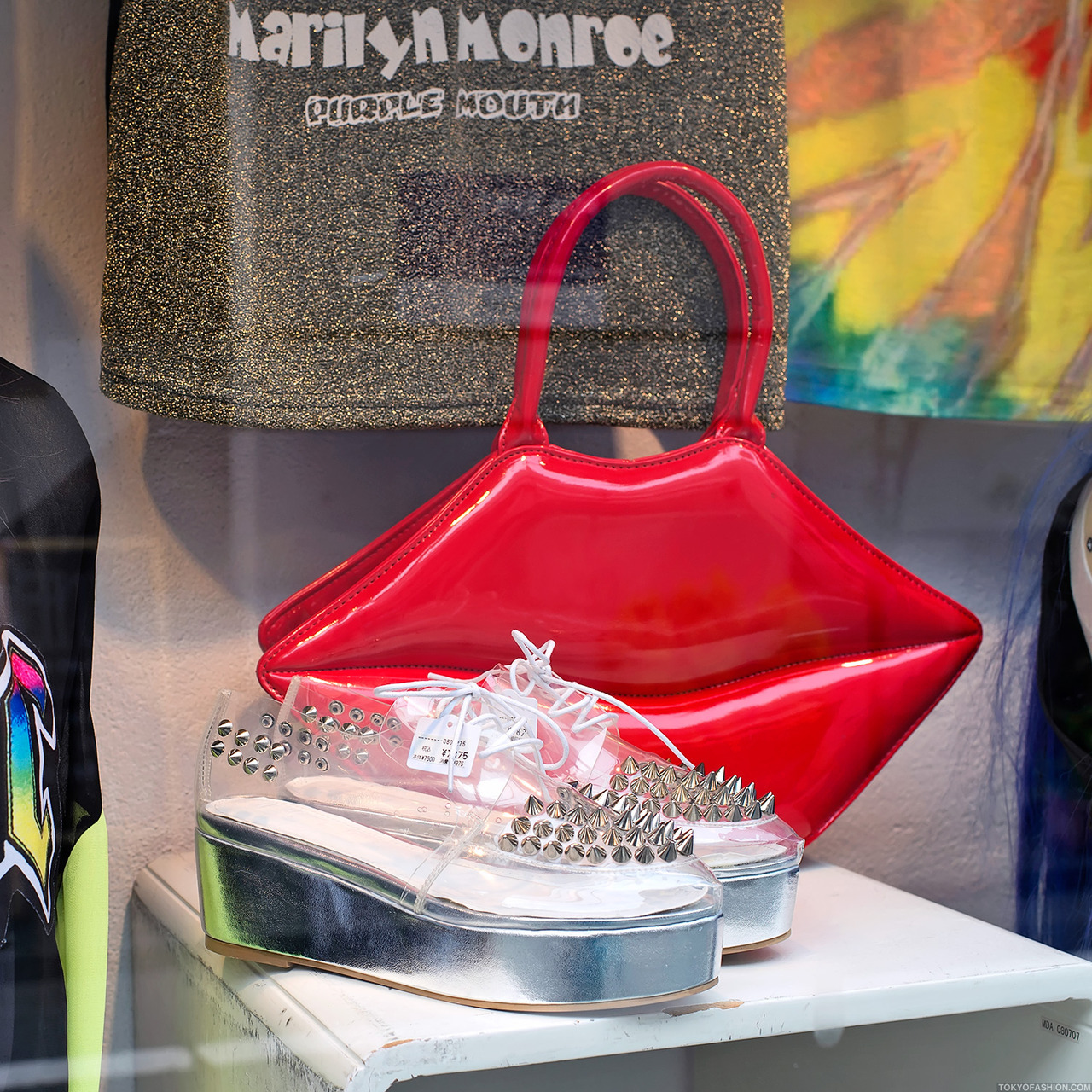 Clear studded platform shoes & lip-shaped handbag at a shop in Harajuku.