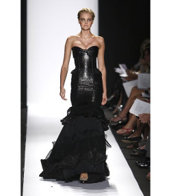 I absolutely love the style of this fishtail dress by carolina herrera, i love how the fishtail styled hem is emphasized by the layers of pleats and ruching, creating more of a gothic and dark feel to the outfit. The length and pleats used within the dress is also reminiscent of trends within the victorian era, making it even more gothic.