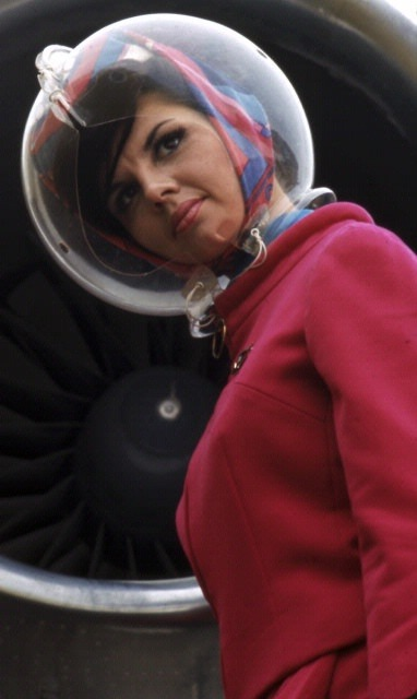 axemansjazz:  Braniff flight attendant. Uniform by Emilio Pucci.
