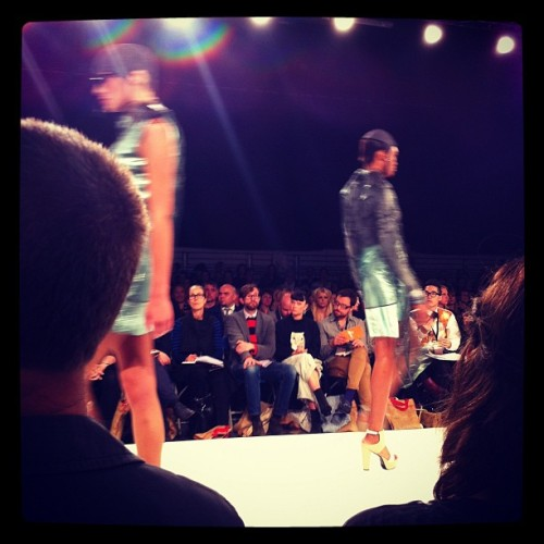 MY GRADUATE COLLECTION CATWALKING AT LONDON GRADUATE FASHION WEEK. METALLIC DRESSES AND SKIRTS, SHEER LAYERS AND HEAD CAPS.