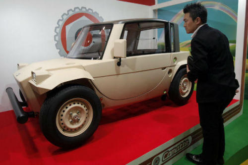 "A visitor looks at a concept of the Camatte electric car displayed by Toyota Motor Co. for children to drive during the International Tokyo Toy Show in Tokyo Friday, June 15, 2012. Toyota thinks these concept cars may encourage a new generation of green car drivers. Koji Sasahara/AP Toyota's Newest Electric Car Is Just For The Kids ""How can we get the next generation driving clean, green electric cars? Toyota thinks it has come up with a creative solution of its own, rolling out a new three-seat electric concept car that the kiddos can drive"""