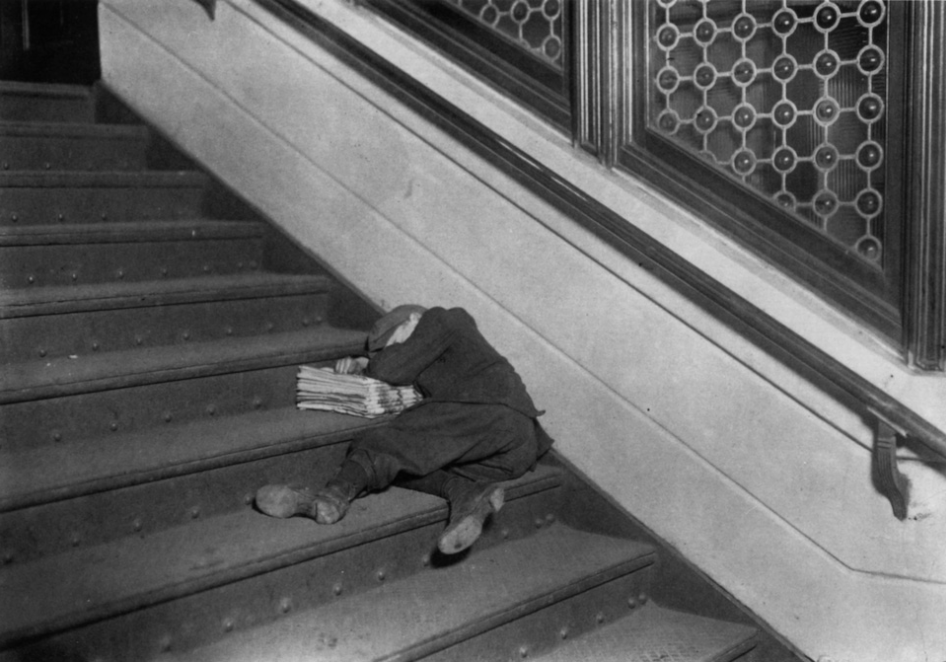 bygoneamericana:  Newsboy asleep on steps, circa 1912. By Lewis W. Hine