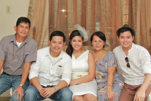 MY DAD, my brother, my sister-in-law, my mom and myself.. my sister is in melbourne so she wasn't able to attend my brother's civil wedding last month.. well anyways, i posted this photo because i don't have a photo of my dad and myself together. I love my dad very much, and i am saying this not because it is Fathers' day, but because i really do. :)