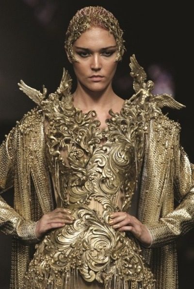 What Would Khaleesi Wear?A gold-flourished dress would accentuate the Targaryen wealth. and those winged angels would be dragons, of course
