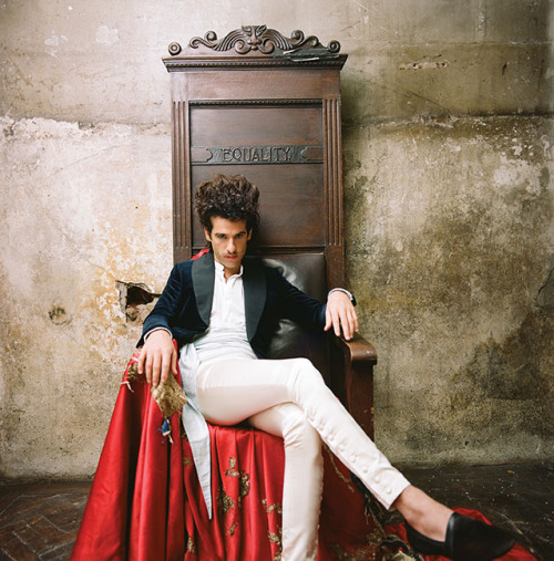 "KING CHARLES INTERVIEW BY AUTUMN DE WILDE & CHARLIE FINK  PHOTOGRAPHY BY AUTUMN DE WILDE ART DIRECTION BY LUCY MOLES STYLING BY DAVID NOLAN GROOMING BY ALISON BUTLER —- AUTUMN DE WILDE—You're both incredibly well dressed. How did that happen? CHARLIE FINK—That's something I think has always come naturally to Charles but something I like to think I've developed over the last few years – it's not always been so easy for me. One of the things I think is annoying nowadays for a musician is that you spend all this time creating a look through styling and taking these immaculate photos with people like yourself [Autumn] and then you go online and it's full of photos someone's taking on an iPhone of you falling out of a venue after a gig looking awful. How does that affect your work Autumn? ADW—I think I'm trying to protect the fantasy of whatever world you guys have created with your music. There's nothing wrong with seeing the real side of things but it seems to be overpowering the fantasy a little bit and I think I would like to see a little more balance. I was going to ask Charles, in building the fantasy that goes along with your music what are some of the influences you draw from? KING CHARLES—There's always been very little that's inspired me, but it's inspired me really heavily and it started with cowboys, watching Tombstone. I wanted to be Doc Holliday, and I'd go out dressed like a cowboy everywhere. I didn't really know that much about fashion – I didn't really know that much about anything – but I wanted to look like those guys. Then I got more into formal dress and wearing classic English garments like suits and tails, but it's bloody expensive to emulate that, so I was always trying to get away with whatever I could get away with. Whatever I could do to impress girls was pretty much the starting point of getting dressed. ADW—Dressing like a proper dandy is a very expensive endeavor, but I actually really like it when it's almost there and it blends with other influences. Charlie, you also have a lot of filmic influences for your music and the band's style. CF —There's been a lot of discovery across this album cycle and finding a look and a feel for the band. We made an album that was our most American influenced record. And I think a consequence of doing that and touring the world and hanging out with you [Autumn], is I've now got a real desire to do something incredibly English or something that connects with that, so I've been watching a lot of David Lean movies and the Brideshead Revisited TV series. The style in that is absolutely amazing. ADW—It's unbelievable. The lighting in Brideshead Revisited is incredible. And speaking of that show, this question feels like it relates a little… Charles, will you talk about when you saw that painting that inspired you, the one that was coincidentally on the cover of your copy of The Picture of Dorian Gray? KC—I went to Scotland with my parents to visit Lord and Lady Dalhousie who have this massive castle in the Highlands. They were showing us around, and showing us the different paintings of their family that went back to the 1100s or something ridiculous. In the dining room I stumbled across a painting by John Sargent of Lord Dalhousie's grandfather. He'd come back from holiday in Egypt and had his portrait painted and it's magnificent. I've always been in love with Oscar Wilde's Dorian Gray and it blew my mind seeing this thing in the flesh. I got a suit made to look exactly like his. Ivory-colored, double-breasted, and I look even better than he does. CF —Who is your tailor?  KC—My tailor is a man called Joshua Byrne of Byrne & Burge. He's an amazing guy and amazing tailor. He doesn't just make you clothes, he believes in the relationship between the tailor and his client. And he's been to every one of my single launches since he first made me a suit. He works by word of mouth and never lets me say anything to magazines. ADW—Too bad! CF —When you do interviews and someone asks you, ""What advice would you give to a band starting out?"" you should say, ""Always have a good relationship with your tailor."" I think it's an important thing for new bands to realize. KC—It is. You've got to look good, you can't just sound good. (Excerpt from Issue 05) More — www.kingcharles-music.com Enjoy more of this on thelabmagazine.com, coming summer 2012!"