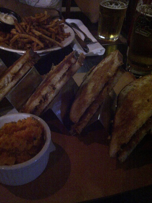The pulled pork grilled cheese at Prohibition is scarily big. I guess at $17, it makes sense. Could've been din for two.  I thought the balance between the bread, pulled pork, and cheese was perfect, with enough flavour from each component. The mashed sweet potatoes that came with it were only average, and I'd suggest the duck-fried frites instead as an option.  It makes me happy that a gastropub has great beers available and a decent menu. The only thing that keeps me at bay is the higher price point.  Sent with Xobni Mobile - http://xobni.com/mobile