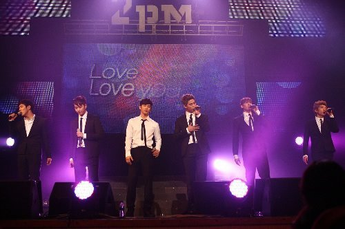 "2PM feature in Philippines leading broadcasting company news site ABS-CBN — Korean group 2PM gets high on fans' love SEOUL, South Korea - Dancing boy bands are a common feature in K-pop, but when it comes to fan loyalty, 2PM has few rivals. Catchy dance pop singles produced by their agency's head producer JYP, intricate choreography that often takes a cue from acrobatics, handsome faces with slick hairstyles gelled to perfection and especially their signature chiseled torsos have driven quite a few fans around the world mad.  In their hundreds of thousands, to put a real figure on it.  Their first Asian tour, which ran from September to March and visited eight states, attracted nearly 160,000 people. Venues were packed every night.  Last month, they sold out six consecutive dates at Tokyo's iconic Nippon Budokan arena — every ticket was purchased under a minute after sale — amassing an additional 60,000. The six members' regular meetings with their official fan club ""The Hottest"" look like a rock-infused church service; women let go of their inhibitions and find (momentary) salvation. They sigh, scream, cry, swoon and of course, sway with the massive group.  Non-Korean fans visit the group's home country and take pictures in front of their agency, JYP Entertainment, in Cheongdam-dong, southern Seoul, as well as billboards with their faces on it, like a pilgrimage. And when controversy arises, the group elicits scorn and fury like no other. Beginning as a seven-member act — with Junsu, Nickhun, Taecyeon, Wooyoung, Junho, Chansung and Jaebeom — the 2009 announcement of the last name's removal from the group brought angry fans holding demonstrations for weeks. What is behind this ardent emotional connection? Even the members themselves want to know. ""I'd guess that it's the 2PM identity,"" says Wooyoung, 23. ""The six members have different individual characters. I don't think we can be called a global group yet, but when we had our first Asian tour … we couldn't believe the love that all the Korean and other fans were showering us with, singing along to our songs in groups."" ""I can't properly describe the feeling on stage when the Cool Ray (lighting device aimed toward the audience) at the Budokan is turned on, which only happens at sold-out performances,"" says Taecyeon, 23.  2PM ""Someone told me that it's really difficult to have the Cool Ray up. When it happens, you can see every face in the house, all the way up to the third floor. It made me unbelievably happy to see the 60,000 fans (over six nights)."" If they were best-known for their precision and synchronized dance moves five years ago, 2PM now seem more at ease, enjoying themselves more and trying to let each personality reflect in music and performance — and perhaps even lose control. ""Compared to our debut stage, we are definitely more relaxed,"" said the rapper. ""And we really know each other like family now. We can improvise a little now because of that."" ""Before one performance, we actually agreed not to rip our shirts off,"" says Junho, 22, referring to one of their signature attractions, ""But as we were coming off stage, we noticed Taecyeon's abs were showing. He explained it as an in-the-moment thing; he said he was high on the fans' love."" The singer added that he and Junsu, one year his senior, are also increasing the level of participation in the creative process, for lyrics, music and the overall concept, among other things. ""We are also saddened by the fact that our overseas activities prevent us from spending more time in Korea and seeing our fans here more,"" says Chansung, 22. ""Stay tuned for our next Korean album, which should be released around this fall. It will be better than what we've done before."" Even in this path of evolution, some things will remain the same — especially their now internationally famous physique. ""All of us are really active and love sports. We like that 'jimseungdol' nickname that fans have coined for us,"" says Nickhun, the sole American member of Thai and Chinese descent who turns 23 at the end of this month, referring to the Korean portmanteau between beast and idol.  ""Instead of a drastic change in image, we want to show the sides we haven't fully explored yet with different staging styles and performances. We are constantly thinking of new ideas and concepts."" And he adds that there is more than just their bodies to be uncovered: ""If you listen more closely to our music, there are softer, more sentimental tracks as well."" NEWS Link:http://www.abs-cbnnews.com/entertainment/06/16/12/korean-group-2pm-gets-high-fans-love"