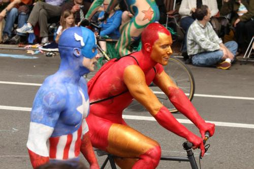 stereowire:  so… this is the solstice parade where i live. naked bicyclists are a big part of it. i've never been, because i work weekends, and also i hate bicyclists. but i thought you guys might get a kick of this. (there's more of Cap, too. like, a lot more.)