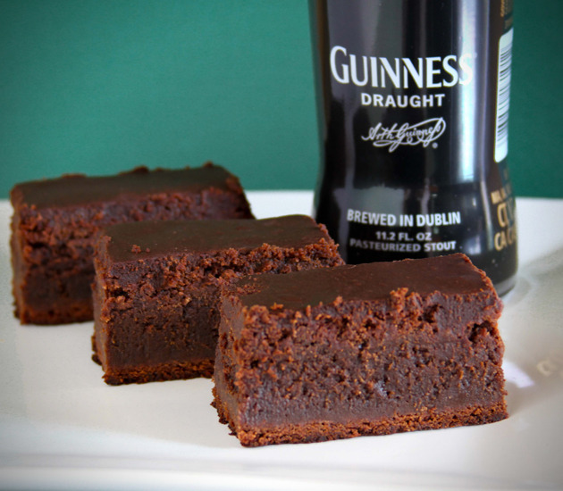brain-food:  Guinness Brownies  Ingredients 1 cup Guinness 16 ounces semisweet or bittersweet chocolate, chopped, divided 1 cup plus 2 tablespoons (2 1/4 sticks) unsalted butter 1 1/2 cups sugar 3 large eggs 1 teaspoon vanilla extract 3/4 cup all-purpose flour 1 1/2 teaspoons kosher salt, divided Directions 1.Preheat oven to 350°. Line a 9x9x2″ metal baking pan with foil, leaving a 2″ overhang. Bring stout to a boil in a medium sauce- pan; cook until reduced to 1/2 cup, about 12 minutes. Let cool. Reserve 1/4 cup stout. 2. Stir 12 oz. chocolate and 1 cup butter in a medium metal bowl set over a saucepan of simmering water until melted and smooth. 3. Whisk sugar, eggs, and vanilla in a large bowl to blend. Gradually whisk in chocolate mixture, then 1/4 cup stout from pan. Fold in flour and 1 1/4 tsp. salt. Pour batter into prepared pan. 4. Bake brownies until surface begins to crack and a tester inserted into center comes out with a few moist crumbs attached, 35–40 minutes. Transfer pan to a wire rack and let cool for at least 20 minutes. Stir remaining 4 oz. chocolate in a medium metal bowl set over a sauce-pan of simmering water until melted and smooth. Add reserved 1/4 cup reduced stout, remaining 2 Tbsp. butter, and 1/4 tsp. salt; whisk until well blended. 5. Pour warm glaze over brownies. Let stand at room temperature until glaze is set, about 40 minutes.Using foil overhang, lift brownie from pan; cut into squares. (via)   I will make these. Soon.