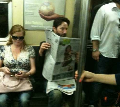"""This guy reading the newspaper on the subway is Keanu Reeves.He is from a problematic family. His father was arrested when he was 12 for drug dealing and his mother was a stripper. His family moved to Canada and there he had several step dads.He watched his girlfriend die. They were about to get married, and she died in a car accident. And also before that she had lost her baby. Since then Keanu avoids serious relationships and having kids.He's one of the only Hollywood stars without a Mansion. He said: 'I live in a flat, I have everything that I need at anytime, why choose an empty house?'One of his best friends died by overdose, he was River Phoenix (Joaquin Phoenix's brother). Almost in the same year Keanu's father was arrested again. His younger sister had leukemia. Today she is cured, and he donated 70% of his gains from the movie Matrix to Hospitals that treat leukemia.In one of his birthdays, he got to a little candy shop and bought him a cake, and started eating alone. If a fan walked by he would talk to them and offer some of the cake.He doesn't have bodyguards, and he doesn't wear fancy clothes.When they asked him about 'Sad Keanu', he replied: 'You need to be happy to live, I don't.'"""