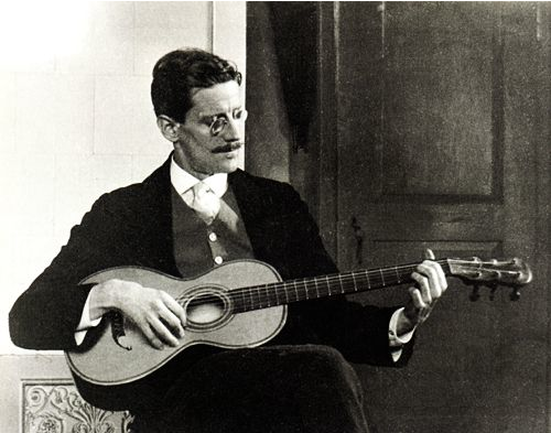 "Ottacaro Weiss     James Joyce Playing Guitar, Trieste      1915 Happy Bloom's Day, June 16, 2012!      Quitting all languor Lionel cried in grief, in cry of passion dominant to love to return with deepening yet with rising chords of harmony.  In cry of lionel loneliness that she should know, must martha feel.  For only her he waited.  Where?  Here there try there here all try where.  Somewhere.                        —Co-ome, thou lost one!                          Co-ome, thou dear one!      Alone.  One love.  One hope.  One comfort me.  Martha, chesnote, return!          —Come!      It soared, a bird, it held its flight, a swift pure cry, soar silver orb it leaped serene, speeding, sustained, to come, don't spin it out too long long breath he breath long life, soaring high, resplendent, aflame, crowned, high in the effulgence symbolistic, high, of the ethereal bosom, high, of the vast irradiation everywhere all soaring all around about the all, the endlessnessnessness…        —To me!         Siopold         Consumed. —James Joyce, ""Ulysses,""  1922"