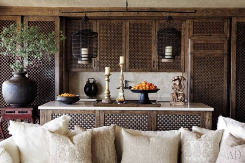Hand carved screens covering the kitchen cabinets and Chinese hanging lanterns Cher's Los Angeles Duplex by Martyn Lawrence Bullard