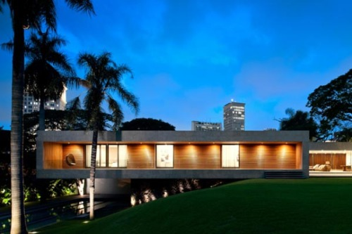 Uncompromising Architecture Architect Isay Weinfeld created the luxury Casa Grécia in Sao Paulo, Brazil. The house combines contemporary architecture with the natural environment. source: thecoolist.com via: WE AND THE COLORFacebook // Twitter // Google+ // Pinterest