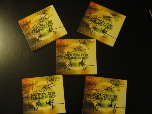 fuckyeahmotioncitysoundtrack:  Do you own a signed copy of Motion City Soundtrack's newest album, GO? No? Well Fuck Yeah Motion City Soundtrack is giving you a chance to win a signed copy of the new MCS album. All you have to do is reblog this photo and make sure you follow Fuck Yeah Motion City Soundtrack. We will not accept likes and extra reblogging of this post will not increase your chances of winning. We will announce the five winners of this contest on Saturday, June 30. The winners will be picked at random. The winners could be international, too! (All the CDs were obtained and signed in San Francisco on June 16.)  Want to win a signed copy of Go?