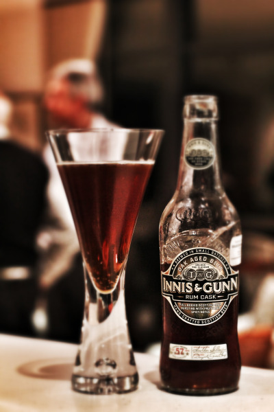 Innis and Gunn Rum Cask  I first tried this beer when YM bought it on a cold winters's night last year at our beloved Five Bar, and boy was it awesome. I loved the marriage of rum flavours with the Scottish ale, and how velvety smooth and sweet the beer was. I was in love. A few times after this, before we started our blog, I returned to this beer as both a comfort beer and for dessert pairing and I was amazed at how every time, I fell more and more in love with it. Last Friday night however, I returned once again to the Innis and Gunn Rum Cask, expecting much of the same, but I was somewhat disappointed. Maybe my tastebuds have grown up and moved on, maybe the beer had been sitting in my fridge for a little too long, who knows… All I know is that the sugary/rum sweetness that I loved so dearly was a little subdued. The beer felt lost in terms of flavour. The X-factor was no more. I will however explain my memories of this beer, and describe why it has such a special place in my heart. The Rum Cask is an interesting conception, as the ale is aged in rum casks for 57 days, before being bottled. These rum casks mellow the ale, and then obviously impart the majority of the sweet and spicy characteristics that are so commonly found with oak aged beers. Upon pouring, you know you're in for a treat, as the rum and sweetness can be smelt straight away. You definitely don't need to stick your nose into this one for confirmation. The ale has a lovely biscuit malt spine, and with it, a few floral hints as well as some spicy undertones. Tasting brings much of the same, with the rum dominating, followed by a smoothness that just makes the 7.4% go down way too easily. My grandpa upon tasting thought that this was more like his type of beer, and my dad especially, who has an almost hatred for anything hoppy loved the sweetness and likened it even to his beloved sticky dessert wine. I think the time has therefore arrived, to put the Innis and Gunn on the shelf, move onto something new and cherish all the good memories I've had with this lovely beer. Bought from the International Beer Shop for $7.80 JG