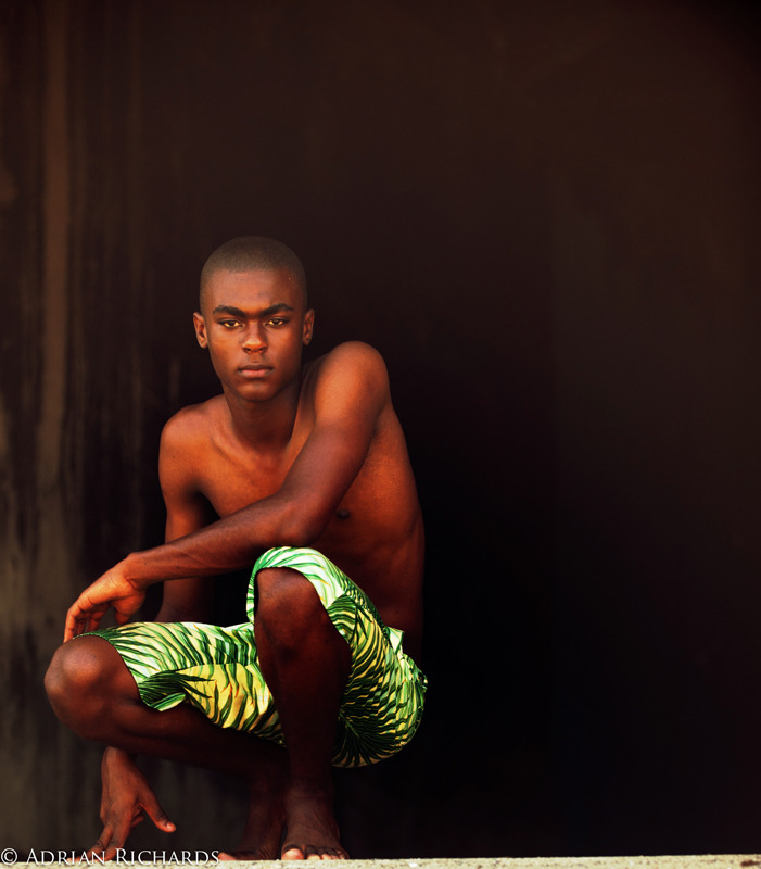 New face Ashawni from Pulse models Jamaica… shot in Kingston…  He wears a palm print St George Fashion House shorts by Kazz Forbes…
