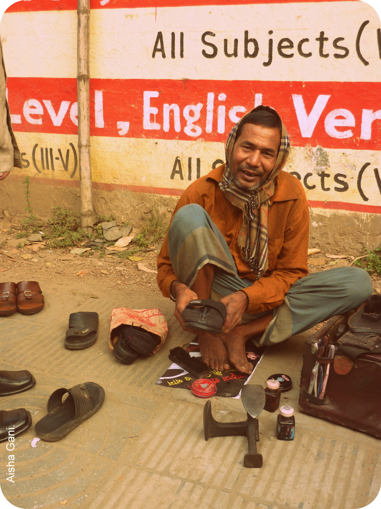 Cobbler. This grin made my day.  Dhaka, Bangladesh.