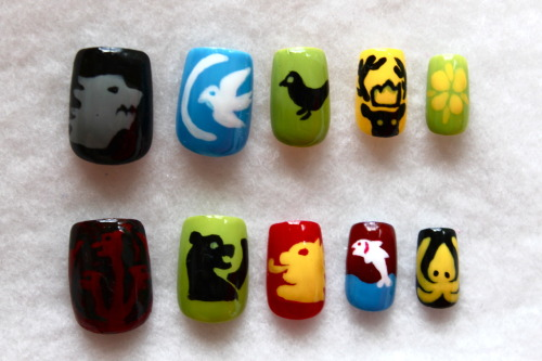 "Game of Thrones nails, nbd.  Top (left to right): House Stark (Direwolf): ""Winter is Coming""House Arryn (White falcon and crescent moon): ""As High as Honor""House Baelish (Black mockingbird as Lord Petyr Baelish's personal sigil)House Baratheon (Stag): ""Ours is the Fury"" House Tyrell (Golden rose): ""Growing Strong"" Bottom: House Targaryen (Three-headed dragon): ""Fire and blood""House Mormont (Bear): ""Here We Stand"" House Lannister (Lion): ""Hear Me Roar""/""A Lannister Always Pays His DebtsHouse Tully (Trout): ""Family, Duty, Honor"" House Greyjoy (Kraken): ""We Do Not Sow"""