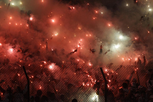 Nelson Antoine/AP Photo Brazil's Santos fans cheer during a Copa Libertadores soccer match against Brazil's Corinthians in Santos, Brazil, Wednesday, June 13, 2012.