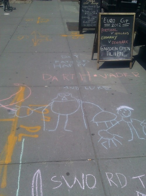 This is on the sidewalk a block from the store. The artist is still chalking it up.   His mom was outside too, and I asked if they knew the book DARTH VADER AND SON. They do—-it was the inspiration for this piece!  All together now: AWWWWWWWWWWWWWWWWWW