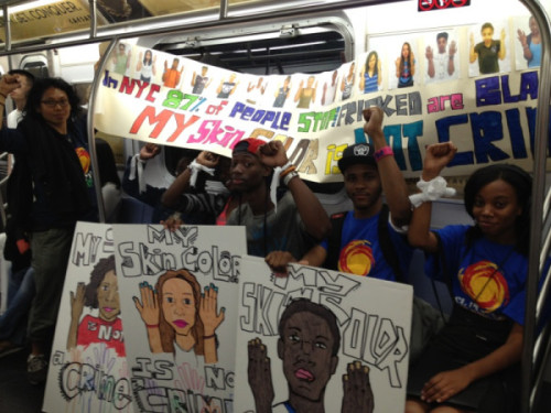 occupyallstreets:  The subway was packed with students heading to the march.  A peaceful protest for an end to police discrimination; a fine (coincidental) tribute to Rodney King.