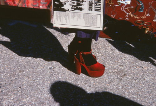 histrionicenlightenment:  A woman in red heels holds a copy of Aftermath by the Rolling Stones at a market somewhere in MexicoMarch 1972