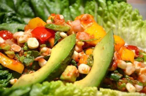 raw-vegan:  Raw Taco Salad Ingredients:  3 or More Ears of Corn (Cut off the Cobb)   1 Carton of Cherry Tomatoes   1 Ripe Mango   1 Large Tomato   Romaine Lettuce Leaves   Small Bunch Basil   Small Bit of Yellow or Red Onion   Bunch of Cilantro   2-3 Stalks of Celery   Juice of Half a Fresh Lemon   Optional: Avocado  Directions: After you cut the corn off the cobb, place it in a mixing bowl. Chop up the mango into small dices, and mix in with the corn. Cut up the cherry tomatoes, and mix them in with the corn and mango. Chop up the onion and cilantro. Add into the mix! Chop up the avocado, and mix it in as well if desired. Slither the romaine and the celery, and mix in as well! Blend up the large tomato with a few sprigs of basil. Pour over the mix and mush in all together! Take a romaine leaf, and fill it up with your new taco salad filling! Take a BIG bite and enjoy!