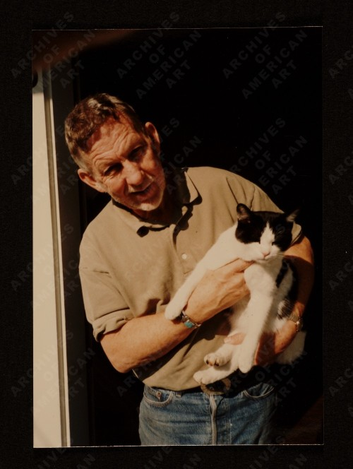 Paul Wonner with cat at front door Jersey St., San Francisco, 1981. Unidentified photographer. Source: Paul Wonner photographs and printed material, Archives of American Art, Smithsonian Institution.