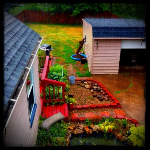 #rain #pond #red #house #garage #porch #patio #roof (Taken with Instagram)