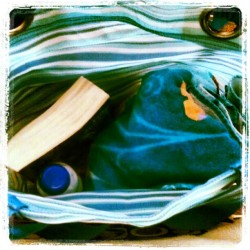 In my bag #photoadayjune #beach #day #towel #book #sunscreen  (Taken with Instagram)