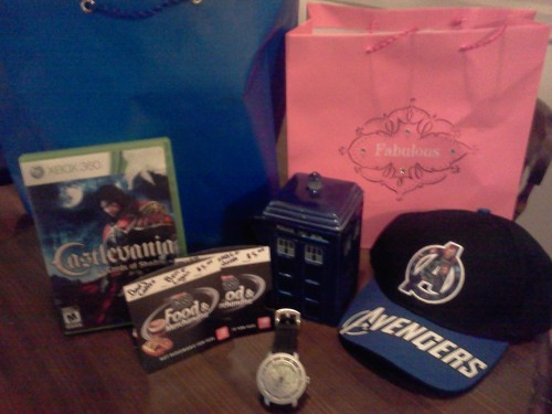 "My Fathers' day haul! A TARDIS coffee mug, an Avengers cap, Castlevania: Lords of Shadows, $10 worth of Speedway gift cards (to buy coffee with!) and an awesome Planisphere Watch, which has a built in star chart showing which major constellations are visible! The ""fabulous"" bag was my oldest son's idea, because he's a little shit of a troll. I had an awesome father's day thanks to my awesome sons and amazing girlfriend!!!"