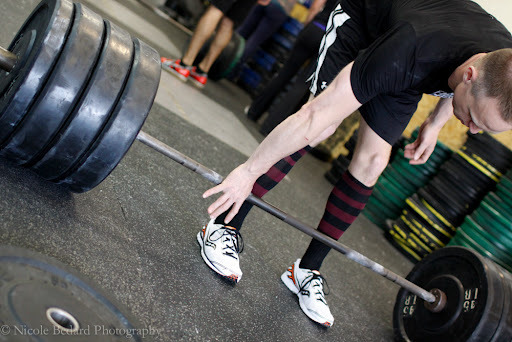crossfittinhawaiiantexaschick:  That moment when you step up to a loaded bar before a lift and suddenly, the world around you disappears. You no longer hear or see the others around you coming to terms with their own barbell. It's all about you and the bar in front of you. It's just you and the bar.