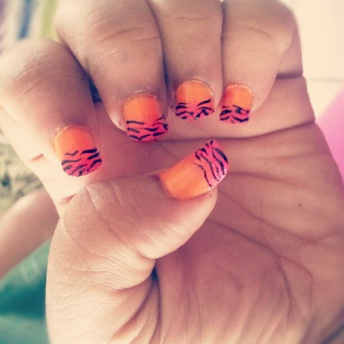 Did my nails today , came out pretty good , looks like a tropical zebra lol (Taken with Instagram)