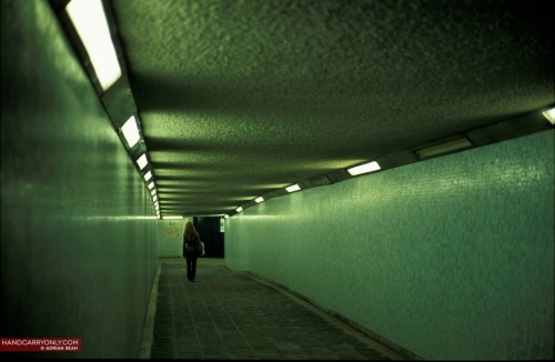 Tunnel Vision (Leica M7, Fujichrome Provia 100F) Her name was like an echo. Every time someone called her they could see how vastly it travelled inside her hollow self, not bouncing until it reached the bottom of darkness she had endless amounts of. She was bored. Bored of life, bored of redundancy, bored of familiar faces. But she never attempted anything different. Like it had encompassed her so gradually, like an hour glass with an endless bottom - so that even when she was engulfed in boredom, she was oblivious in it's grainy texture. She walked along the same route to get home. The same route she embarked on for the past ten years. It was only this overly humid night, that she realized that only the sounds of her footsteps surrounded her through the tunnel. She took a deep breath and yelled out her name and watched as it warped old structure. She gasped, taken aback by her own spontaneity. She looked around at the still empty tunnel; finally hearing the sounds of the hourglass. Conversations by the Window Seatis an ongoing creative collaboration between Adrian Seah and Romila Barryman, with photos and writing themed around a common love of travel and discovery. View other Conversations by the Window Seat or read more of Romila's writing at her blog Daydreamsonlooseleafpaper