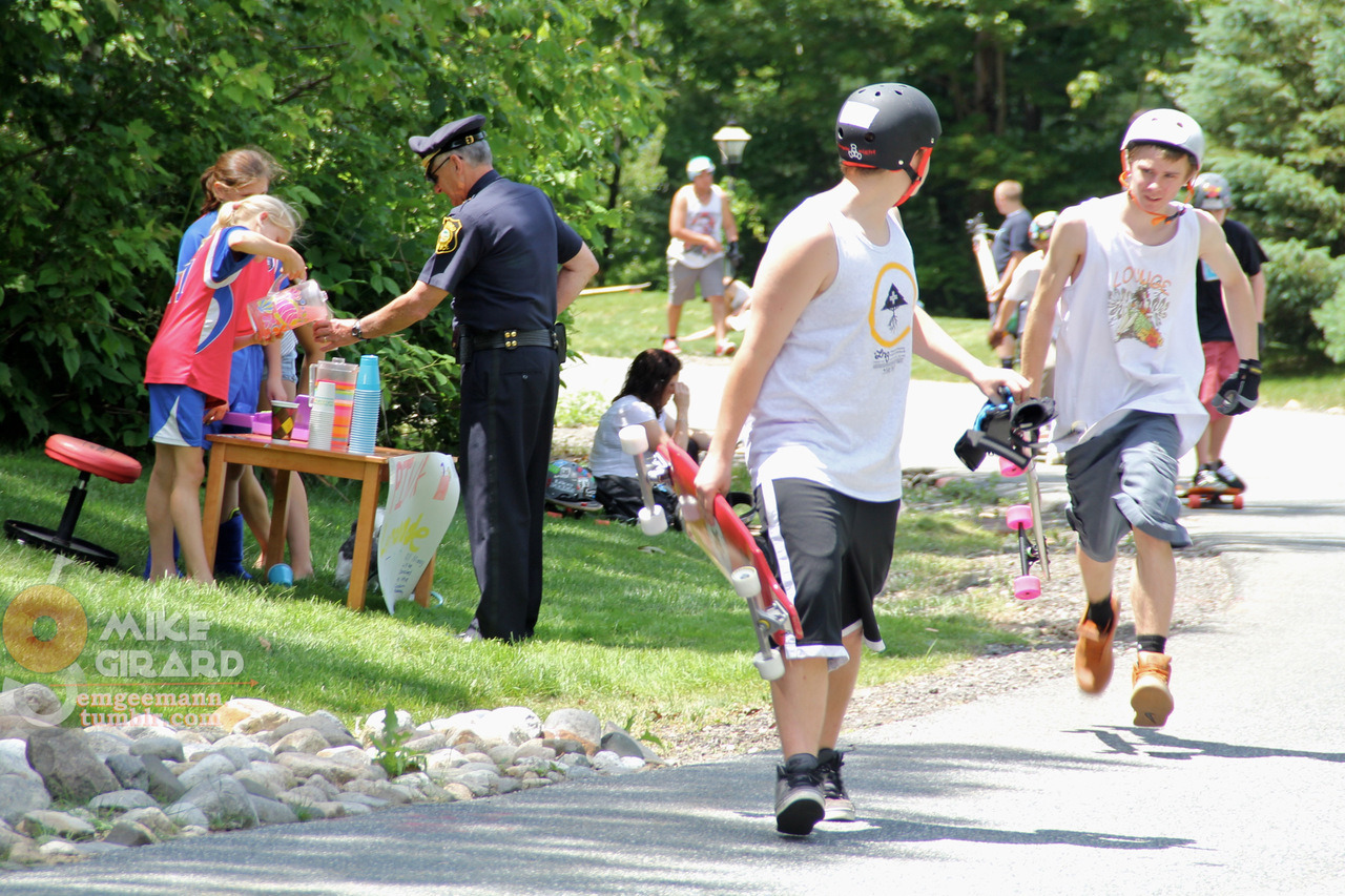Policeman buys pink lemonade at roadside stand, Longboard for Life. This is why closed-road events are awesome. -Mike