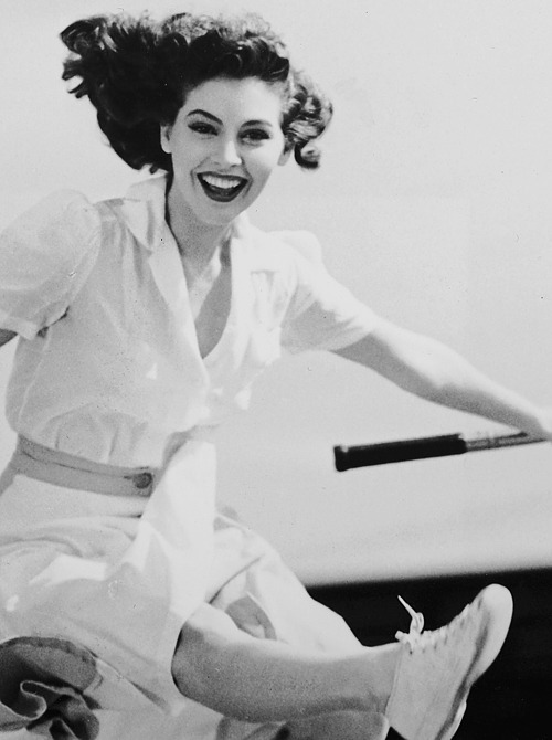 deforest:  Ava Gardner jumps over a tennis net, 1940s.