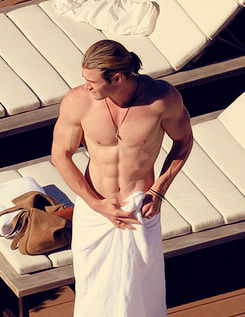 Chris Hemsworth shows a muscular and fit body by the pool in Sydney June 17, 2012