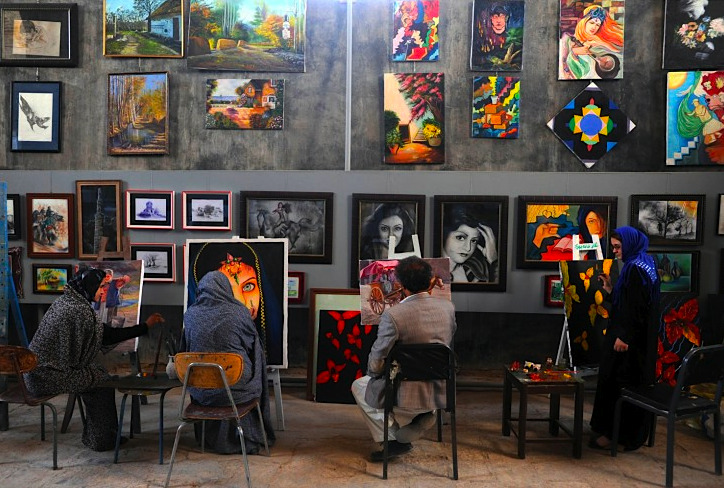 Afghan youths learn how to paint at the Behzad Art Gallery in Herat. The Taliban, ousted from power in a US-led invasion in 2001, banned girls from going to school and forbade people from painting and learn the arts.