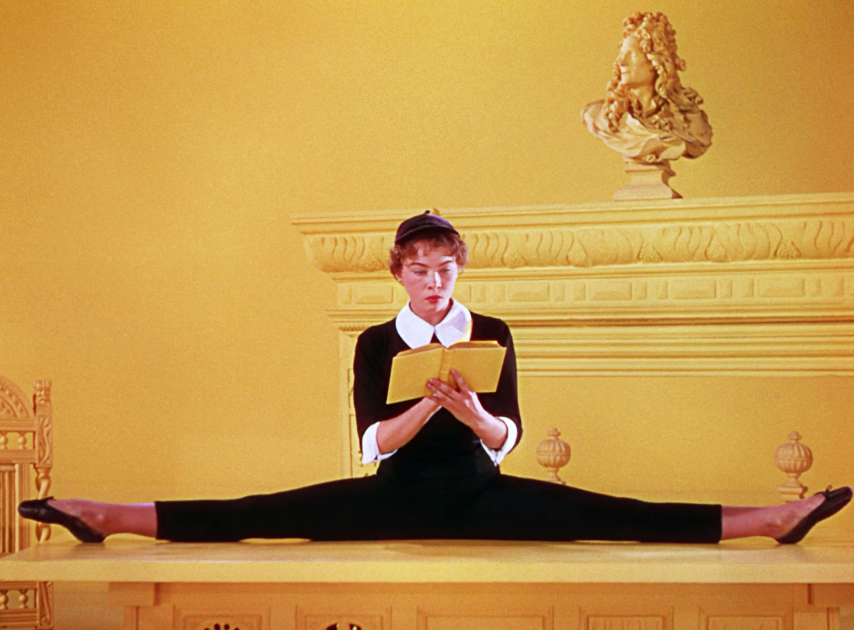 Leslie Caron reads. fashion-and-film:  An American in Paris (1951)