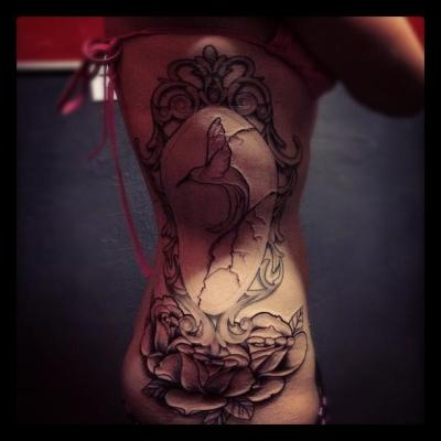 This is my lovely mirror side piece. I got this tattoo at Covenant Tattoo in Fort Collins, CO by Jon Sanders. This tattoo represents a lot of things to me, hummingbirds hold a special place in my heart and have for a long time. I also used to have self esteem issues; hence the mirror. The mirror is cracked to show my improvements over the years and that things don't always necessarily have to be perfect in order to be beautiful. I still have the color to add. I want the roses to be dusty pink and the hummingbird will be shades of green and blue. Every time I look at it I smile. Period. :)