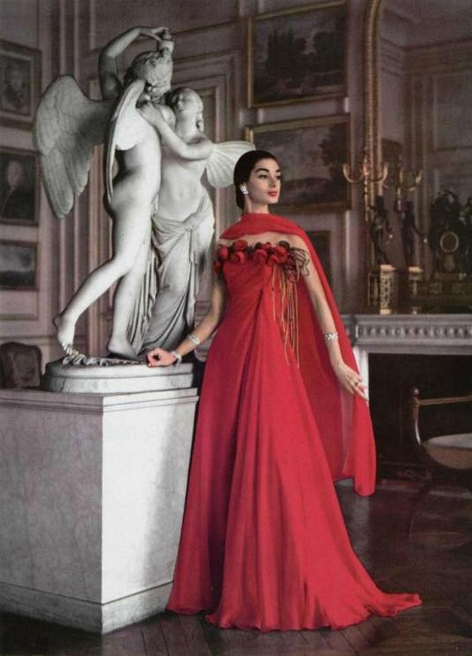 theniftyfifties:  Model wearing a rose trimmed gown by Gres for L'Officiel, 1956.