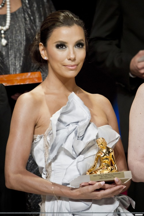 Eva Longoria with her Awards at 52nd Festival of Monte Carlo, France.