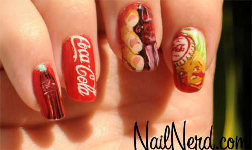 Classic Coca-Cola inspired nail art on a base of Essie Russian Roulette