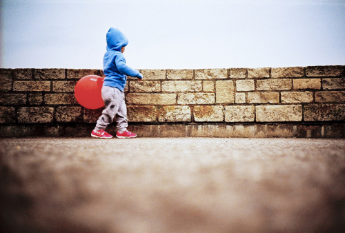 lomokev:  Matilda, red ball & sea wall on Flickr.Talking a little stroll in west bay, Dorset. Taken on a little holiday we just had.