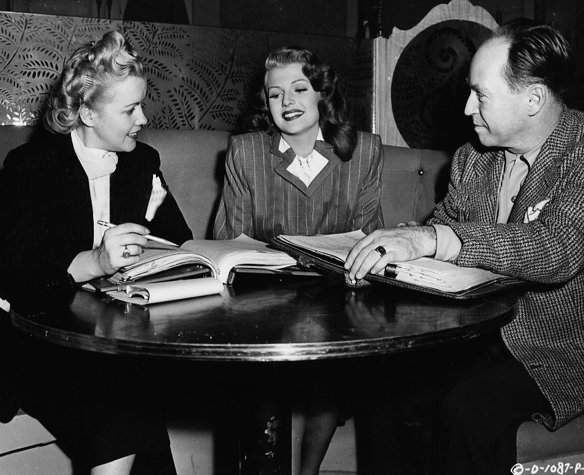 Rita Hayworth and the writers of Gilda (1946) behind the scenes of the movie.
