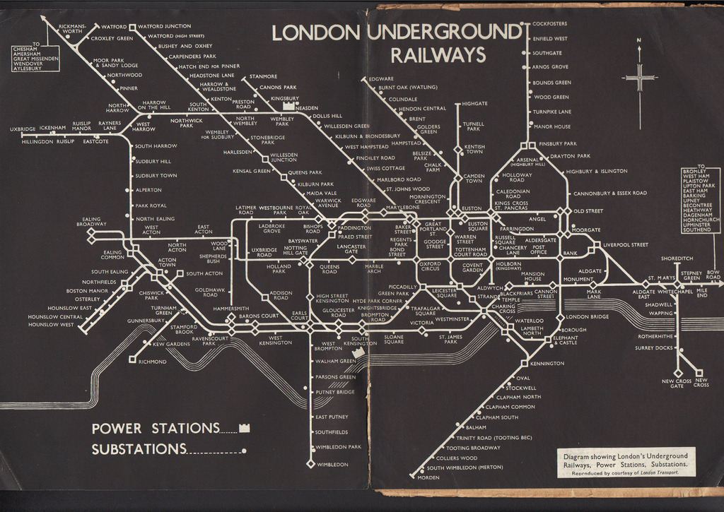 Historical Map: Diagram Showing London's Underground Railways, Power Stations, Substations, 1933 Here's a fascinating reworking of Harry Beck's original 1933 Tube map that I haven't seen before. Apparently it's from an article in a journal from November 1933 that details the work required to upgrade the electrical services on the Underground. Apart from the stark black and white treatment and addition of the power stations and substations, what's really interesting about this map are the little tweaks and changes that have already occurred since the first edition of the map, produced just months beforehand. The Northern end of the Piccadilly Line has now reached Cockfosters, whereas the original map shows it as under construction. The District Line also no longer reaches Uxbridge, being replaced by Piccadilly Line service. The eastern end of the District Line on the original map just bled off the edge of the page; now it has a (slightly cramped) arrow head indicating that the line continues. In fact, apart from the use of diamonds for interchange stations instead of circles, this map actually has far more in common with the 1936 edition of the London Underground Map than the 1933… which just goes to show how Beck - ever the perfectionist - was always tinkering with and perfecting his design. (Source: IanVisits/Flickr)