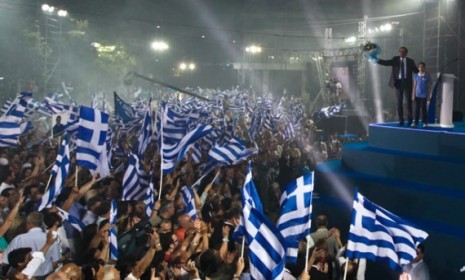 "Greek voters went to the polls on Sunday to decide the make-up of their next government and, in many ways, the fate of Europe's single currency, the euro. The result of the closely fought election: A ""knife-edge"" victory for the center-right New Democracy party, which supports enacting EU-backed austerity measures that Greece must observe to remain a member of the eurozone, narrowly beating the leftist Syriza party, which ran on a strong anti-austerity platform. The 30 percent to 27 percent edge gives New Democracy (ND) 129 of the 300 seats in parliament, and ND leader Antonis Samaras is expected to form a government with the once-dominant centrist Socialists (Pasok). Syriza head Alexis Tsipras vowed to keep his party in opposition, pushing for stimulus spending and against austerity. Where does this leave Greece, Europe, and the global economy? Here, four takeaways: 1. Greece will stay in the eurozone for now…""This is the outcome that markets have most wanted to see,"" says Joe Weisenthal at Business Insider. If New Democracy and Pasok form a workable coalition — which seems likely — the Greeks will accept austerity and at least temporarily avert a disaster for the euro, Europe, and the rest of the world. But Syriza won more than one-fourth of the vote, proving that ""a large segment of the population despises the EU-imposed austerity measures,"" says André Gerolymatos in Canada's Globe and Mail. But a loss is a loss, and in the end, ""the Greeks came to edge of the precipice but at the last minute stepped back."" 2. …But may still exit laterThe fact that ""the Status Quo party"" beat the ""the Stop the Austerity Party"" should ""give a financial markets a brief breather,"" with the emphasis on ""brief,"" says James Pethokoukis at the American Enterprise Institute. Even if ND and Pasok can form a pro-euro coalition, Greece's ""economy is just too sickly to met the bailout requirements,"" even if Germany loosens them a bit. The bottom line: Uncertainty about Greece's financial stability, even with these austerity measures, will ""drive the EU into a deeper recesssion,"" meaning ""Greece is still likely headed for the exits this year."" 3. This is a Pyrrhic victory for the pro-euro sideNew Democracy essentially won the right ""to continue pursuing an unworkable policy,"" says Paul Krugman at The New York Times. ""Yay!"" And the scuttlebutt in Greece is that ""Syriza didn't really want to win,"" since one more (inevitable) failure on the ND's part will completely discredit ""the entire Greek center,"" leaving Tsipras to pick up the pieces. 4. Germany will decide Greece's fateIf you want to know Greece's future, look to Berlin, says The Wall Street Journal in an editorial. New Democracy's Samaras will almost certainly ask Germany's Angela Merkel to relax the terms of the bailout, and ""would the German chancellor dare to say no, thus becoming the proximate cause of a first euro exit?"" She ""might have preferred a Syriza victory,"" since it would have given her ""an excuse to cut Greece out of the eurozone."" Perhaps, but while Greece is ""not without sin,"" its problems are largely due to ""other people's hubris,"" says Krugman in The New York Times. ""The only way the euro might — might — be saved is if the Germans and the European Central Bank realize that they're the ones who need to change their behavior."""